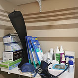 Cross section of footcare clinic showing supplies like creams, sterilization kits, masks, sterilization pouches, gloves and such supplies.