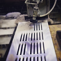 Waterjet cutting angled slots into a new