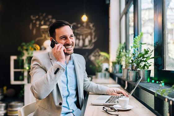 happy man working in coffee shop.jpg