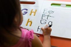 little-girl-coloring-the-alphabet.jpg