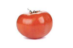 Fresh Beefsteak tomato over the white ba