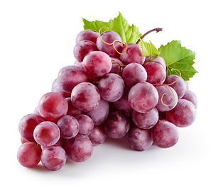 Ripe red grape. Pink bunch with leaves i
