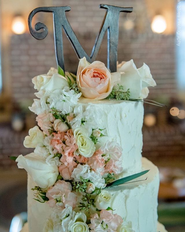 Fresh flowers are my favorite on wedding cakes! These soft florals were the perfect touch to our 4-t