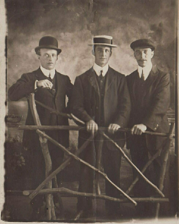 Photograph of Clifford Amos (centr