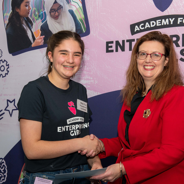 COSBOA Director and Treasurer, Elizabeth Skirving, presenting a participation certificate to one of the girls in the program