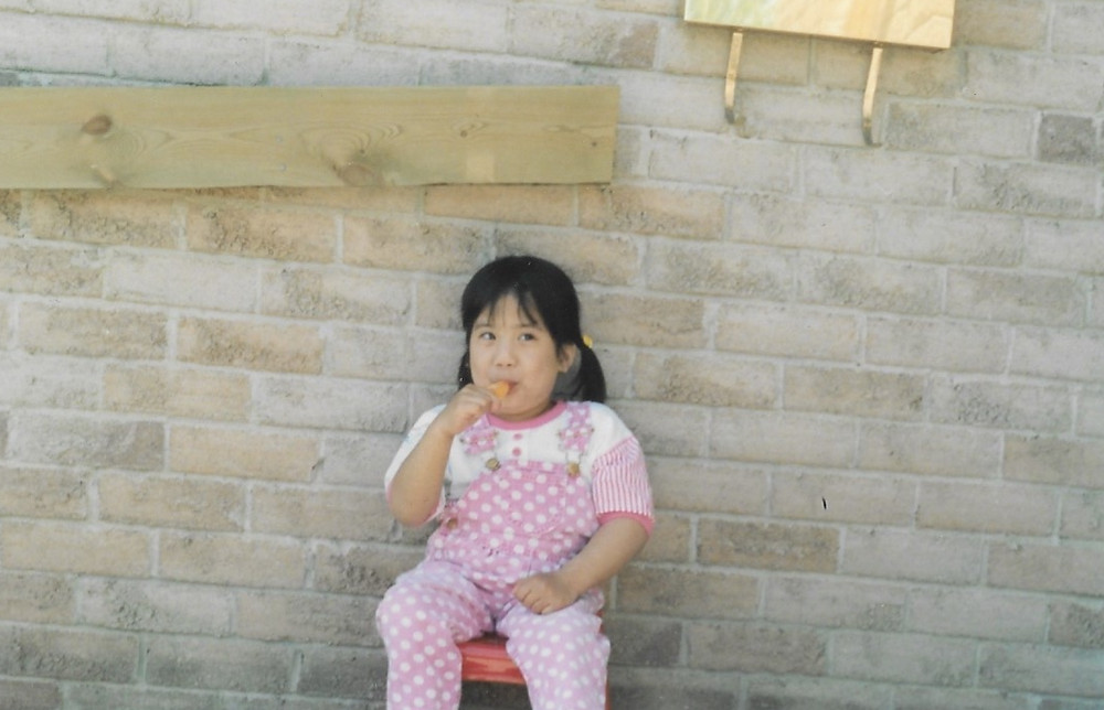 Eating a popsicle outside when I was a child.