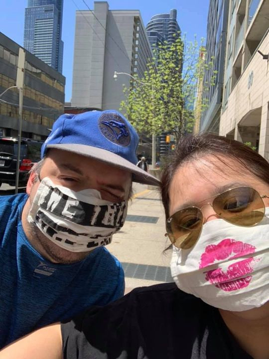 A couple sitting outside wearing masks during the Covid-19 pandemic