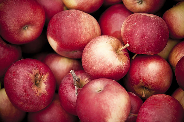 closeup-shot-of-red-apples-on-top-of-each-other.jpg
