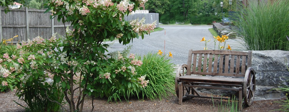 A picturesque garden at the Shaker Mill Inn