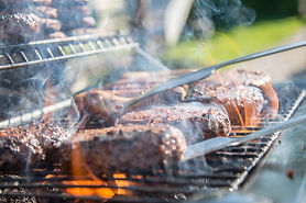 close-photography-of-grilled-meat-on-gri