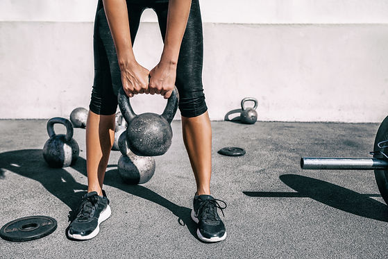 Kettlebell weightlifting athlete woman l