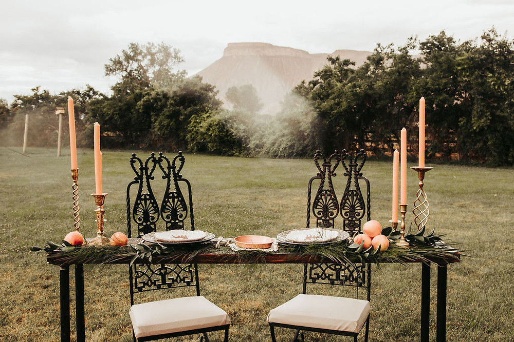 Mt. Garfield wedding with victorian chairs at sweet heart table orange tapers in brass candlesticks