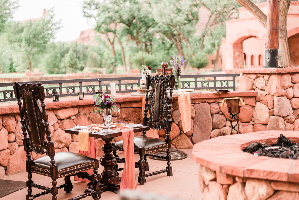Sweetheart table at Gateway Canyons Resort, ornate wood chairs, fire pit, red rock, Colorado