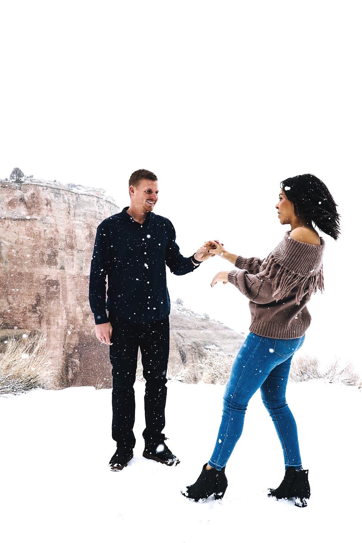 Snowy engagement Colorado Monument