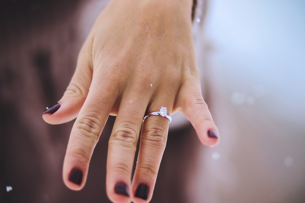 Snowy solitaire engagement ring burgundy nails