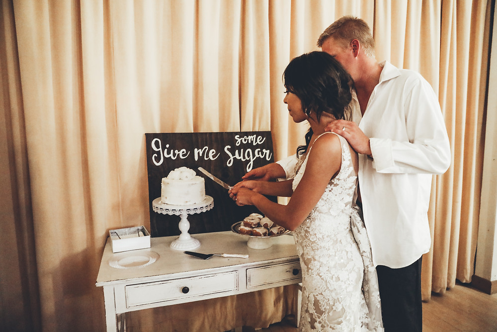 wedding cake cutting at Silverthrone Pavilion with donuts