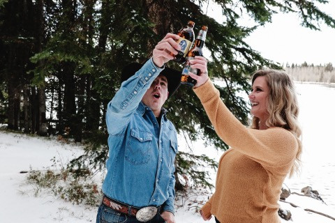 Snowy engagement on the Mesa Colorado, beers, cheers