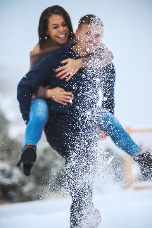 Snowy engagement couple Colorado Monument Mountains
