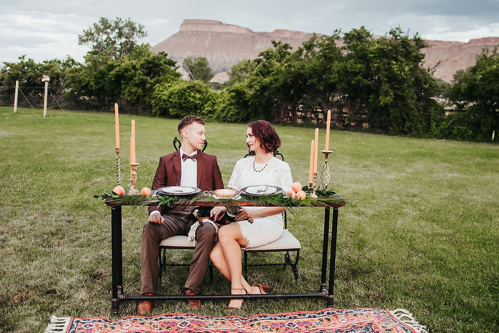 Wedding seating with sweetheart table dramatic at Palisade River Ranch Mount Garfield