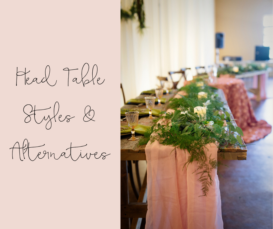 Barnwood head table with greenery, vintage glassware, blush chiffon runner