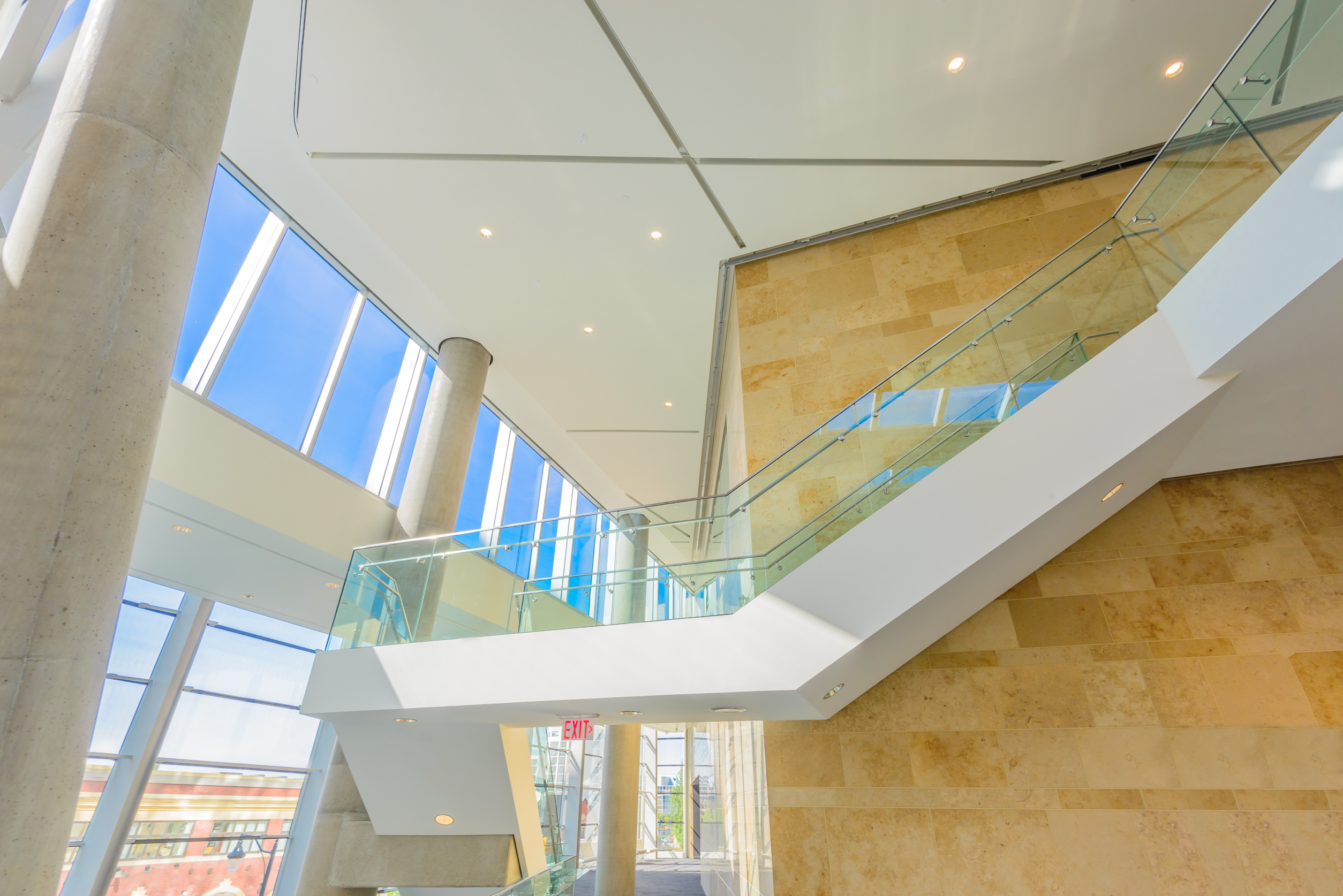 Window and blue sky. Abstract fragment of the architecture of modern lobby, hallway of the luxury ho