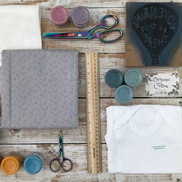 paints, stamps, fabric, wadding and scissors