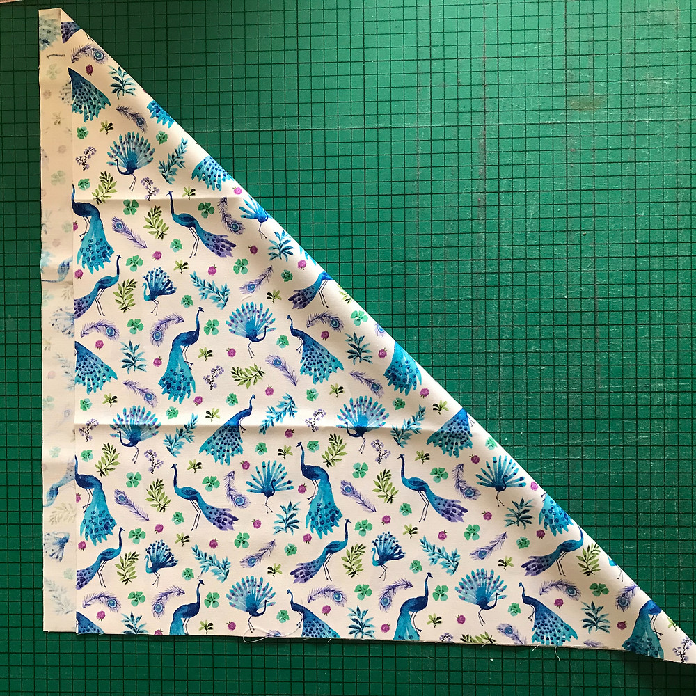 Fold diagonally to get the perfect square