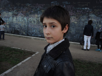 Young boy , on the banks of the Seine