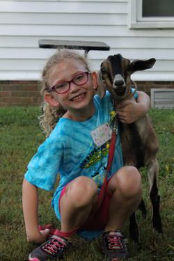 Camper with their baby goat