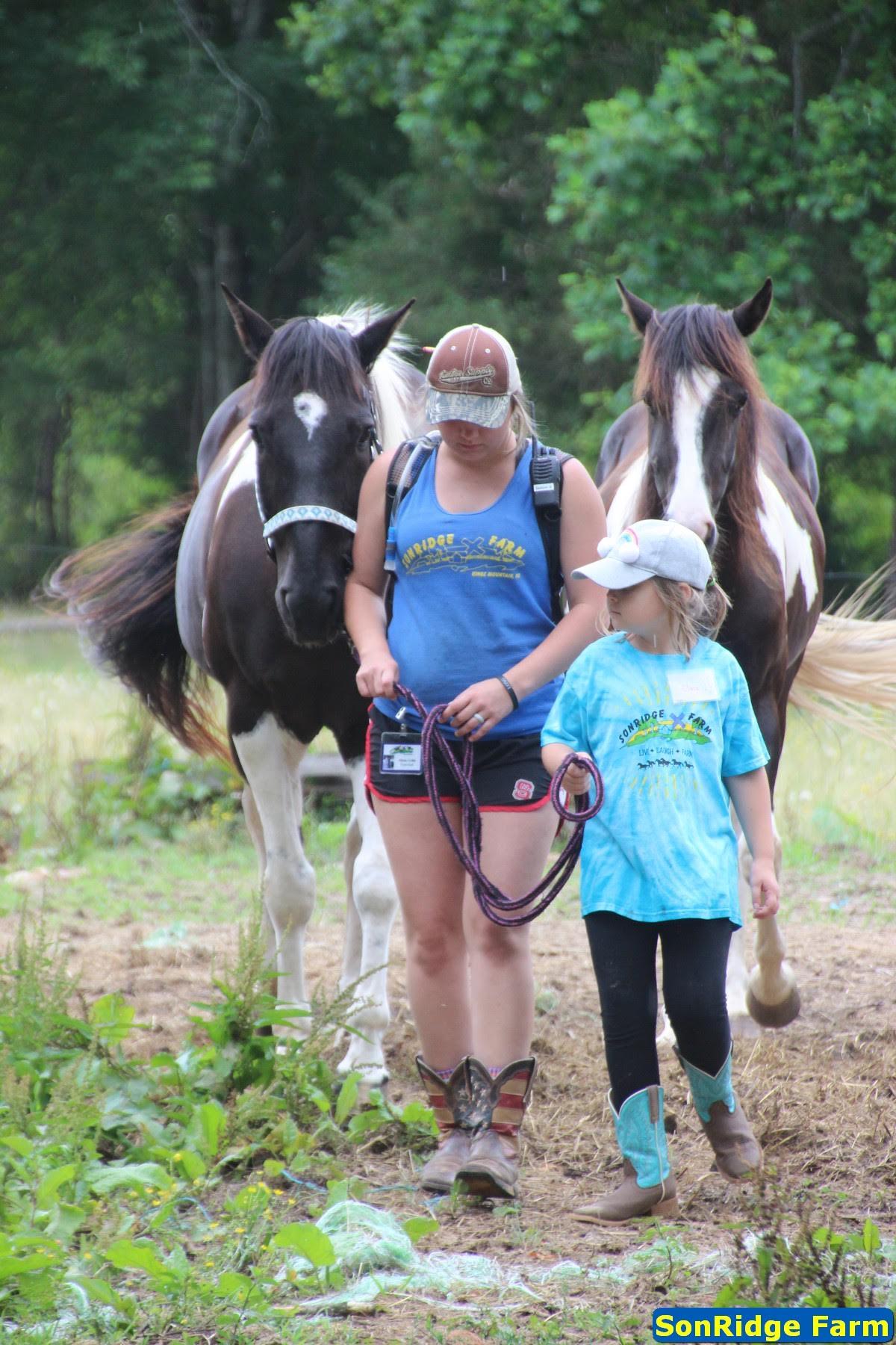 Camper leading horse