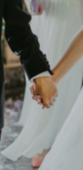 woman-wearing-white-wedding-gown-holding