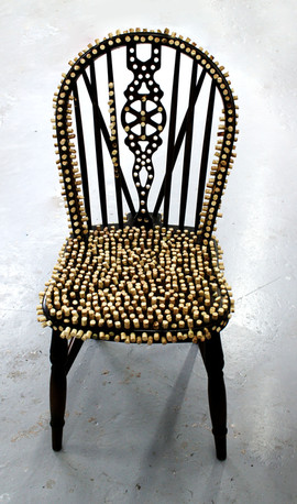 Chair Covered in Wooden Dowels