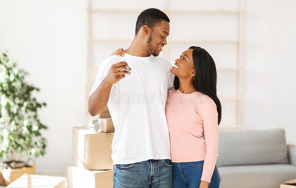 relocation-concept-happy-black-homeowners-key-to-their-property-hugging-looking-each-other