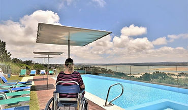wheelchair lady by the heated panoramic pool