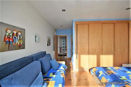 interior of the white bedroom in casa do lago