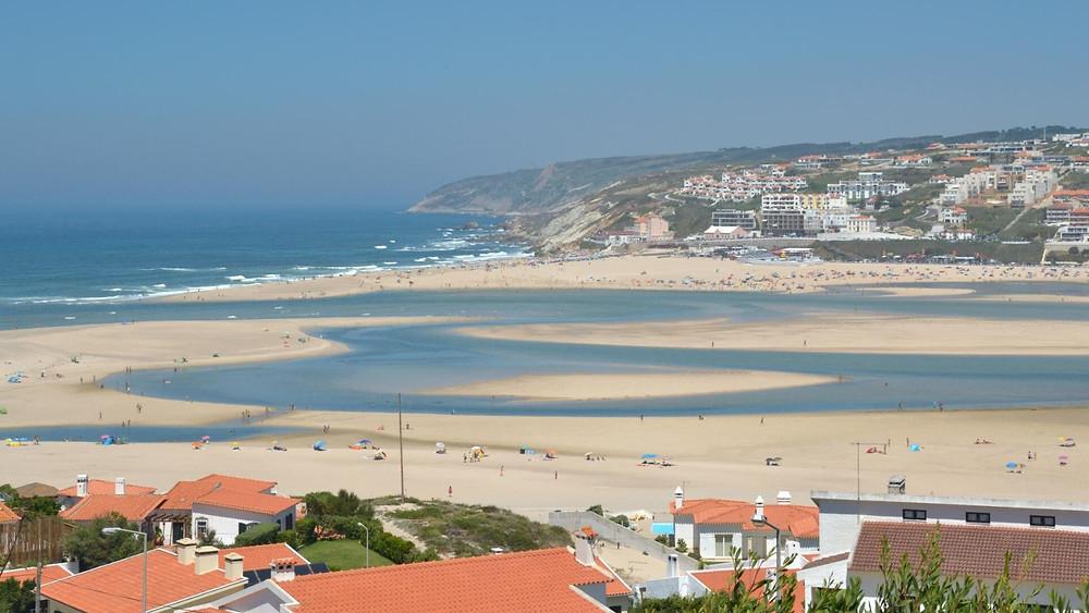 Vast, white sandy beach and Obidos mouth lagoon at Foz do Arelho, Portugal