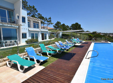 Twelve sun loungers inside the pool gated area, at the holiday villa Casa do Lago, Portugal.