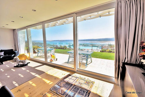 Large living room looking out to breathtaking views, perfect for family holidays