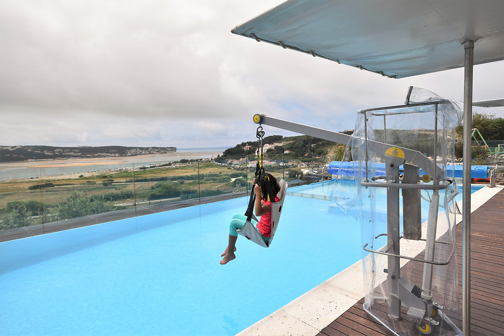 Pool hoist in action at Casa do Lago