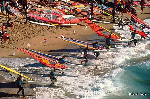 windsurfers going to the water