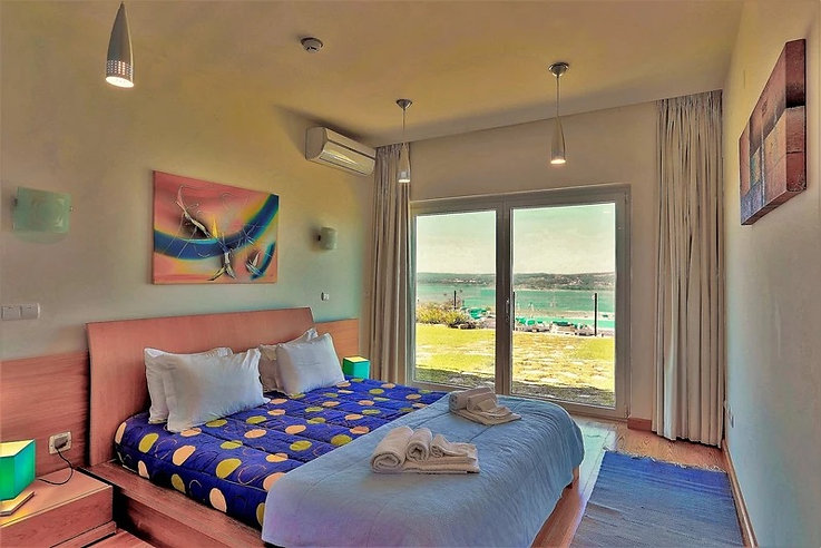 blue bedroom at pool level: best villa for large families