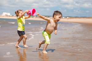 Photo of kids playing on the beach