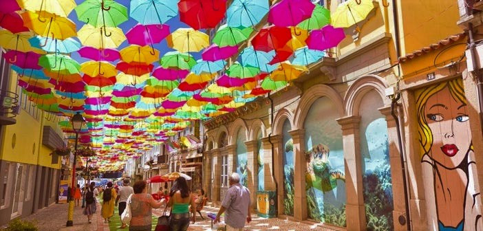 Street decorated by colourful umbrelas, attending the umbrela festival