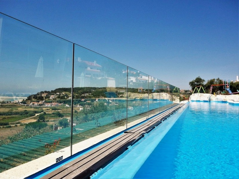 Transparent fence protection of the safe pool in the holiday villa Casa do Lago