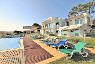 Large, heated, private and fenced pool area with 12 sun loungers.