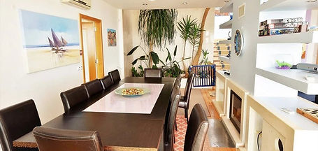 dining table in casa do lago, luxury family villas