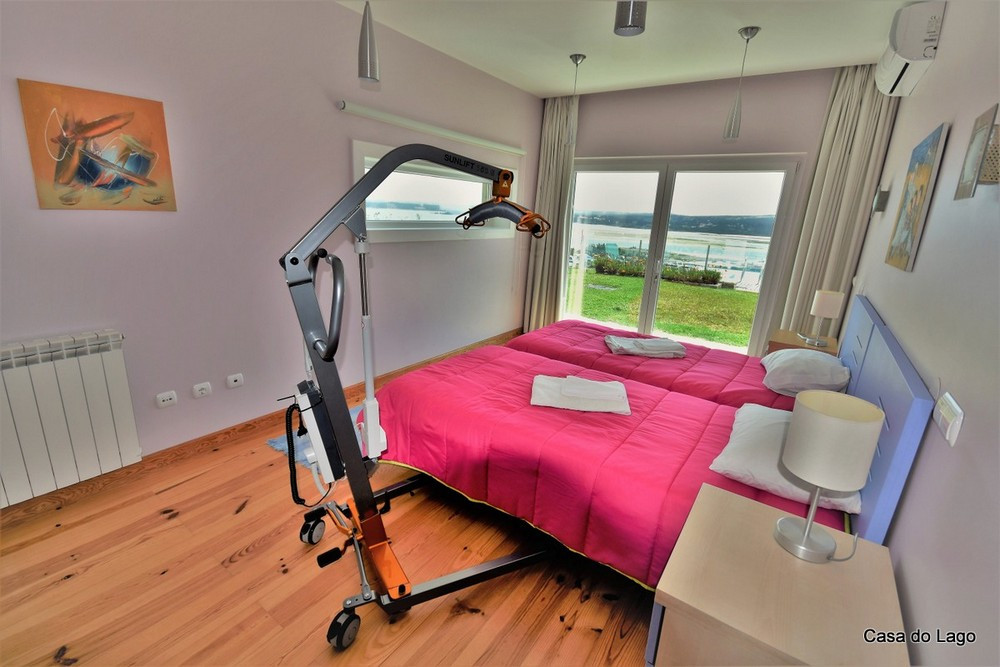 villa with adapted bedroom with profiling bed and electric hoist
