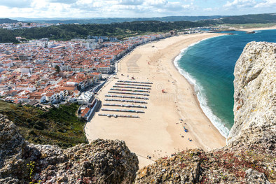 Nazare beach viewed from the Promontory, at 25 minutes from Casa do Lago luxury holiday villa