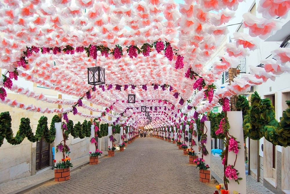 Street superbly decorated with flowers during the Campo Maior Flower Festivities in Portugal