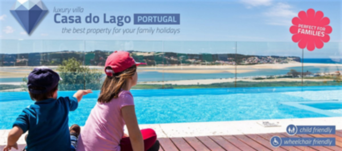 Kids by the heated pool at Casa do Lago Portugal - villas for big families